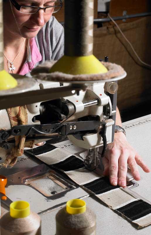 Seamstress-applying-piping