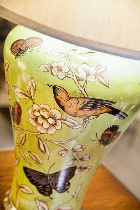 Birds and butterflies lamp, green with floral patterns.