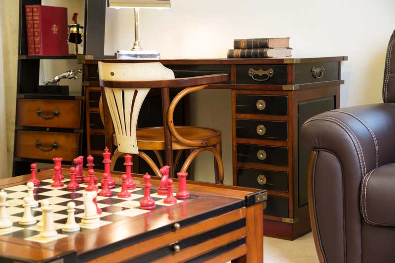 Solid cherry wood campaign desk, black painted drawers, brass fittings