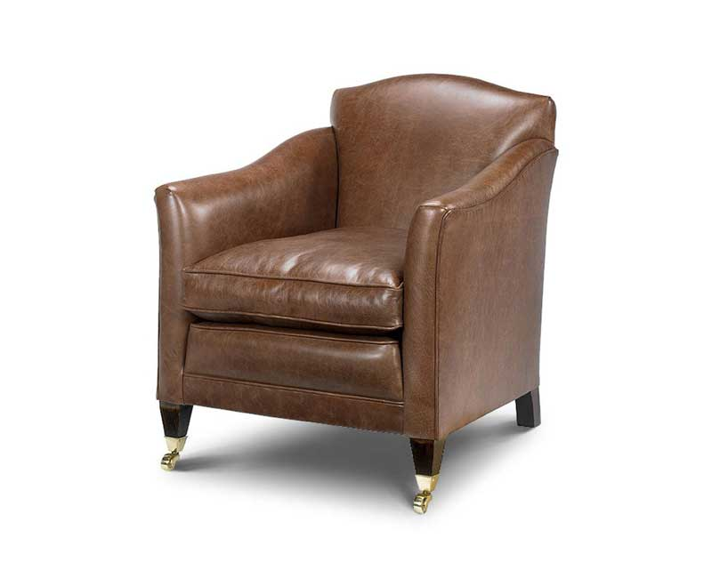 Leather Arm Chair, Curved Arms, Wooden Feet, Brass Castors.