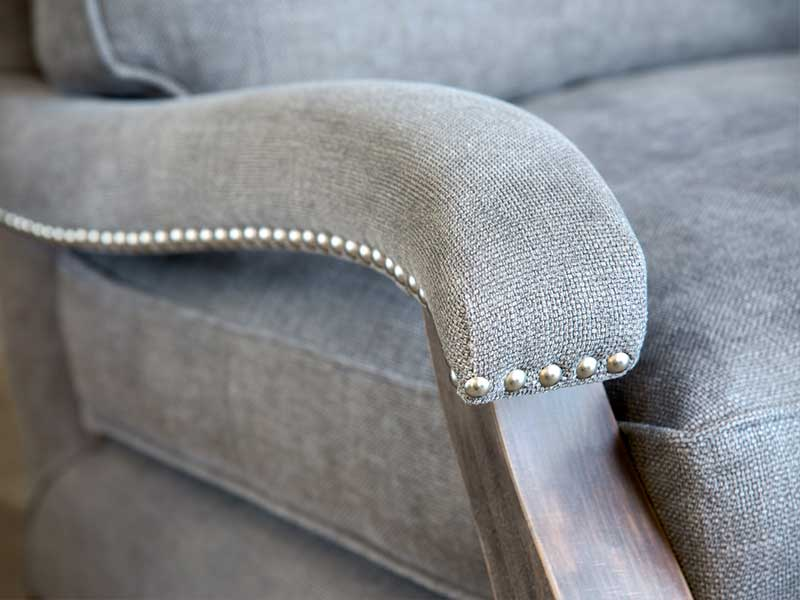 Arm Chair Detailing, Grey Fabric, Dark Wood.