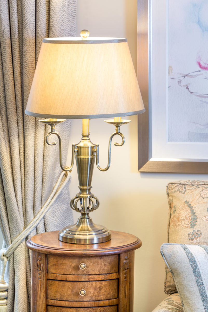 Silver lamp, twin arms, cream and silver shade.