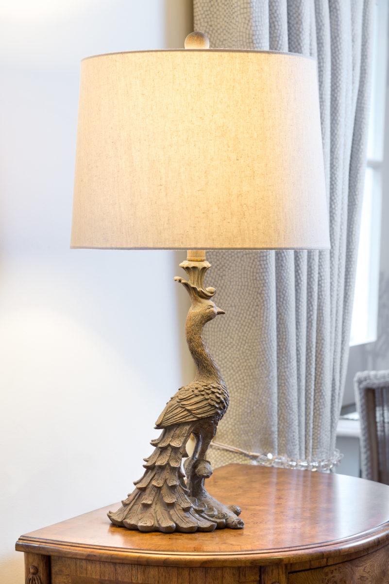 Peacock lamp, resin, cream shade.